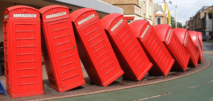 Lots of red phone boxes toppled over onto each other