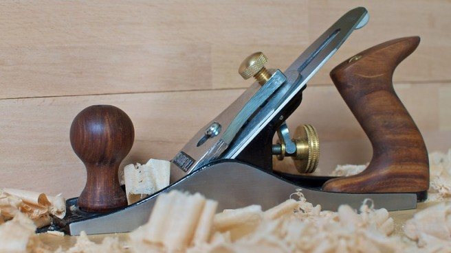 Wood working plane among some wood shavings