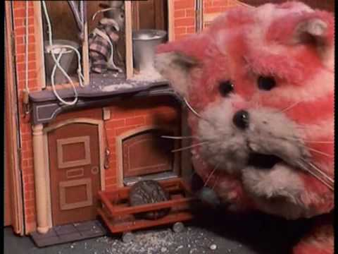 A scene from Bagpuss, where the mice appear to use a special mill to make chocolate biscuits out of butter beans and breadcrumbs