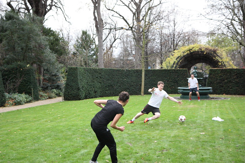 People playing football in a garden